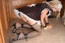 Кроссдрессер в кандалах моет пол как служанка
